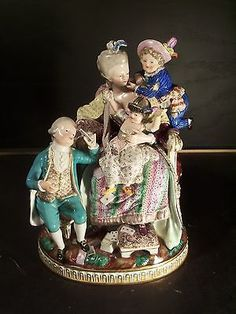 A MEISSEN GROUP OF 'THE GOOD MOTHER'. After a model by M.V. Acier and J.C. Schönheit, modeled as a mother in 18th century dress sitting in an armchair as her three rambunctious children surround her. | eBay!