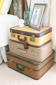 Great storage idea for a side table in the travel themed guest bedroom/office