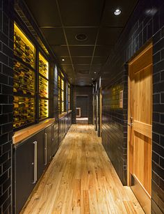 Wine coolers are seen in a back hallway at LX in Boston