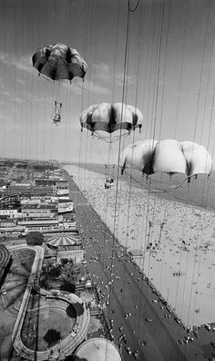 1 July 1962: The view from the Parachute Jump at Steeplechase Park shows crowds on the beach, the boardwalk and amusement area at Coney Island