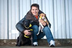 """John Barrowman Photos - Entertainer John Barrowman is seen out promoting the Dog Trust, spreading the message """"A dog is for life, not just for Christmas"""". Barrowman happily posed with pups Mouse the Black Labrador and Vincent the Jack Russell Terrier. - John Barrowman Promotes Dog Trust Dogs Trust, John Barrowman, Animal Magnetism, Man And Dog, Black Labrador, Jack Russell Terrier, Hot Dogs, Puppies, Poses"""