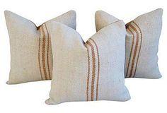 A set of three pillows custom-made from a vintage European grain sack textile.