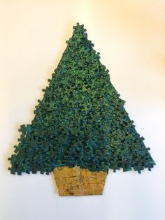 DIY Christmas Tree made from Jigsaw Puzzle pieces. Texture Decoration Holiday Unique