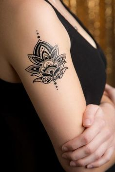 """Our Henna Lotus Temporary Tattoo features the classic lotus flower design. This custom tattoo is perfect for yoga fanatics and every day use. - Tattoo Size 3.75"""" x 4.5"""" - 2 Tattoos Included"""