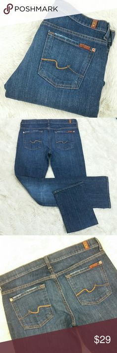 """7 For All Mankind Bootcut Stretch Jeans Size 30 Dark blue wash signature bootcut jeans with tan squiggle back pockets. Button and zip fly. Soft and stretchy 98% cotton and 2% spandex. Factory distressed hems and pocket seams. Preowned in good condition with no rips, holes, tears or stains. Size 30  Waist 16.5"""" Rise 8"""" Inseam 34"""" Leg Opening 8.5"""" 7 For All Mankind Jeans Boot Cut"""