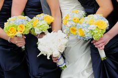 Spring wedding flowers ... bridal bouquet - an elegant mixture of cream roses, mini white calla lily, stephanotis with crystal accents and white hydrangea.  Bridesmaid bouquets were fresh spring clutch bouquets filled with light blue hydrangea, yellow roses and green mini hydrangea. | Long  Island wedding florist Bella Flowers