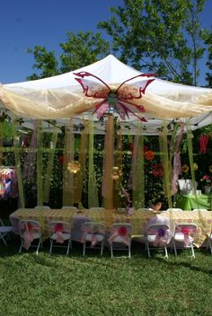 Decorate an EZ-up with sheer fabric for a perfect garden party.