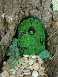 green fairy door, fun idea to the big sweetgum tree out front