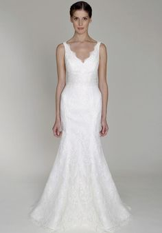Ivory re-embroidered lace V-neck sheath with trumpet skirt | Monique Lhuillier | https://www.theknot.com/fashion/1317-bliss-monique-lhuillier-wedding-dress