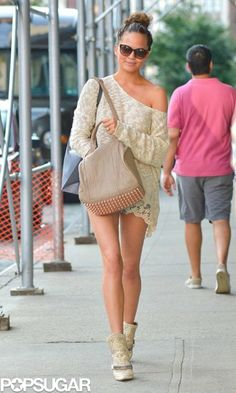 For a hot day in the city, Chrissy Teigen went the cool-girl route in a slouchy knit, cutoffs, and Isabel Marant boots.