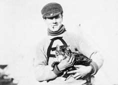 A Canadian soldier with 'Tabby' the cat, his unit's mascot, on Salisbury Plain on 27 September 1914.