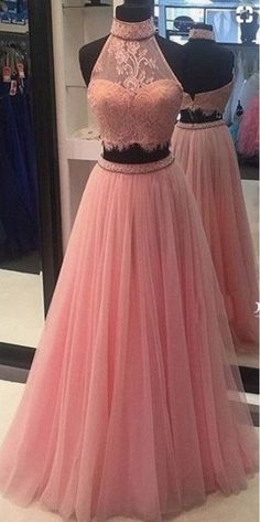 A pink high-necked lace ball gown.