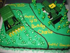 My great nephew wanted a cotton picker and a combine on his fourth birthday cake.  I got some ideas from cakecentral, and winged it the rest of the way.  It was fun!!