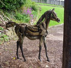 Arabian foal driftwood bronze sculpture by Heather Jansch  Saw this in a gallery in downtown Victoria this weekend - just stunning.