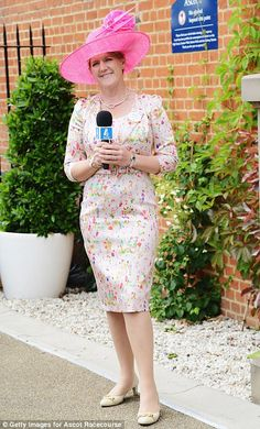 Bold choice: Clare Balding was elegant in floral print and a huge pink hat