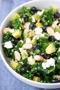 This Kale Superfood Salad with Quinoa and Blueberries is loaded with super foods! This healthy salad is make ahead friendly for quick lunches. Goat cheese, avocado, and a honey lemon dressing bring lots of flavor to this gluten free power salad! kristineskitchenblog.com