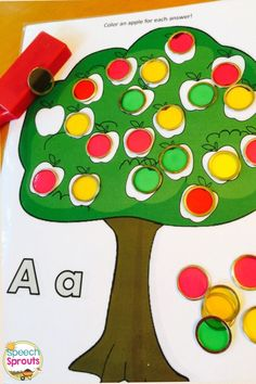 FREE Apple game! Roll a dice to see how many chips to put on the board. Comes in BW too for dot markers.