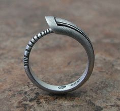 Ouroboros Ring, contemporary design, in textured, hammered and oxidized silver. Made to order, needs three weeks to complete. $79.00, via Etsy.