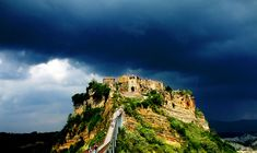 """The """"dying town"""" of Civita di Bagnoregio, Viterbo Places To Travel, Travel Destinations, Pedestrian Bridge, The Province, What A Wonderful World, Ghost Towns, Wonders Of The World, Monument Valley, Tourism"""