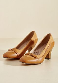 Set the conference off on the right foot by clicking these tan pumps to the podium and sharing your inspiring words! A professional pair with a vintage-y touch, these faux-leather heels feature imitation suede inserts, gold-buckled accents, and squared-off toes, adding timelessness to your talk.