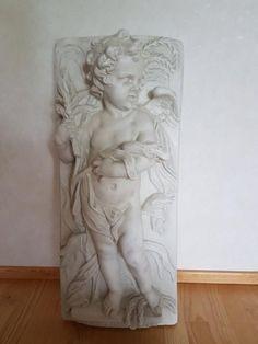 Iso enkelilapsireliefi seinälle