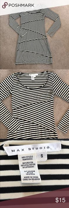 Black and white stripped dress Black and white stripped dress. Cute and comfy. Great for all seasons. It is pretty lightweight and soft. Like new condition, only worn a few times. Falls past fingertips but above the knee. Formed fitting not clingy though. Dresses Midi