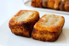 Slices of bread, covered with a thick meat sauce, topped with cheese, breaded and fried.