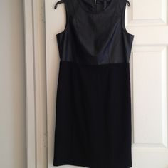 CHICO'S BLACK LABEL faux-leather dress Elegant dress by Chico's Black Label with faux leather top and a rayon blend on the lower body. Exposed back zipper.. In great condition Chico's size 0.5 which is a regular size 6. Chico's Dresses