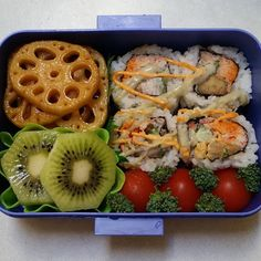 Lunch time! Spicy crab roll, marinated lotus root, kiwi, and tomatoes & broccoli. #bento #nomnomnom #sushi