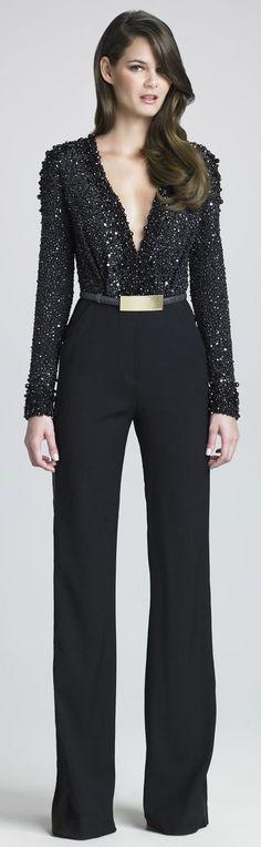 Shop this look on Lookastic: https://lookastic.com/women/looks/black-sequin-jumpsuit-gold-waist-belt/22863   — Black Sequin Jumpsuit  — Gold Waist Belt