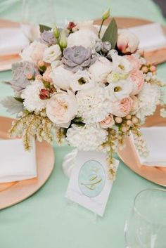 blush and mint wedding flowers on table with just a hint of gold