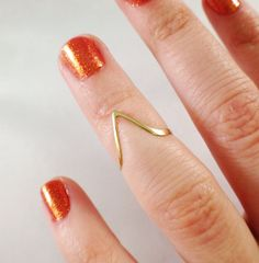 Midi ring Etsy listing at https://www.etsy.com/listing/165577501/solid-10k-gold-chevron-ring-first