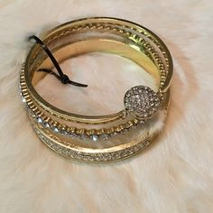 Trés Chic Gold and Faux Diamond Bangles Stunning gold and faux diamond bangle set. Wear together, alone, or stack with your favorite bangles. Brand new, never worn, perfect condition. Adrienne Vittadini Jewelry Bracelets
