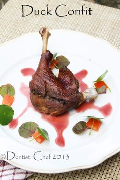 """French Style Duck Confit de Canard with Reduced Red Wine Recipe. Confit (French) pronounced as """"con-fee"""" is slow cooking method in French culinary. Confit contains various kinds of food that subm… Duck Leg Recipes, Meat Recipes, Wine Recipes, Cooking Recipes, Goose Recipes, Savoury Recipes, Slow Cooking, Turkey Recipes, Gourmet"""
