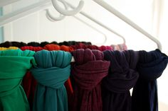 Scarves and tights can be organized by color - tie them onto hangers to easily see them in the closet.