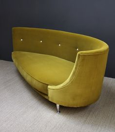 Large Italian Asymmetric Sofa    An Italian sofa of large proportions and unusual asymmetric design. On steel legs and newly re-upholstered in mustard velvet. Designer unknown.  c.1960's