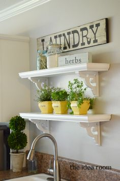 I like the look of these shelves and you could put some cute little plants on them with some other decor! Look beyond the laundry sign :) ha