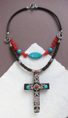 Main thing about this piece of jewelry is that youll have two items in one: double-faced convertible necklace with a cross pendant that can be worn two sides. Stylish ethnic necklace that can be more colorful with gemstones at one side or elegant at other - according your mood and inspiration. Surprise your colleagues and friends, pay for one, get a lot of options on weekdays and holidays, suitable for any of your dress.  For assembly I used: gemstones - coral, turquoise. Tibetan silver and…