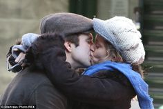 Smack! Sebastian Stan and Margarita Levieva stopped for a kiss while shopping in New York City on Sunday