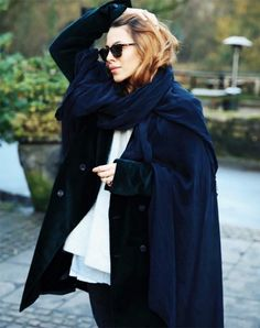 Maja Wyh layered a white t-shirt with a black coat, cozy scarf, and skinny jeans