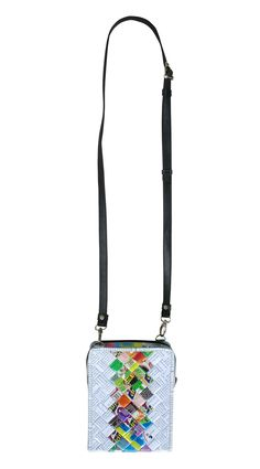 This small zip crossbody bag is made using disposed office document paper (the white part) and candy wrapper (the middle part). Cut into strips, laminated and woven tightly. It has a zipper closure and adjustable length strap made of vinyl. Perfect size for all types of cellphones.  Features: YKK top closure zipper Polyester fabric for lining. This bag has no inner pockets.  Dimensions in inches: Height 8, Length 6, Thickness 1.7  Dimensions in centimeters: Height 20 cm, Length 15.5 cm…