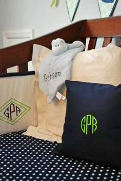 navy and green nursery bedding. Need to make these pillows.