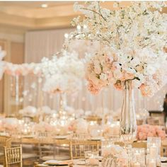 Please please let me make this for your wedding. Ughhh! Gorgeous white and peach centerpiece of hydrangea, blooming branches and roses
