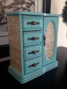 Redesigned jewelry box with chalk paint and scrapbook paper.