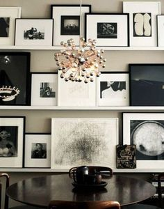 Black and white or monochrome art wall shelves - an alternative to a gallery wall that allows for overlaps and easy updates.
