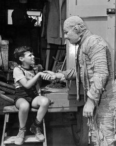 "Lon Chaney Jr and a fan on the set of ""The Mummy's Ghost"" (1944)."