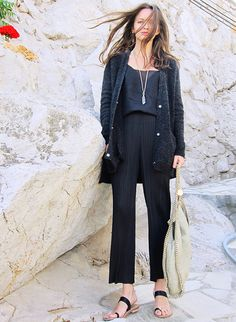 Cropped micro-pleated trousers, minimalist sandals and a long cardigan