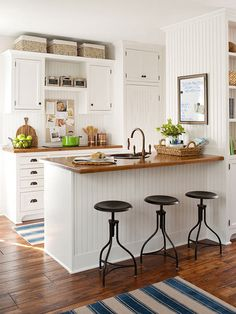 Let's talk today about decorating above kitchen cabinets. In my current kitchen, this isn't an issue, but it was definitely an issue in the townhouse we used to live in. The tricky part…