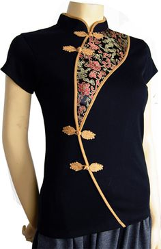 SOPHISTICATED LADY: Sophisticated but sexy all-cotton women's Chinese top in midnight black has silk brocade inset in burgundy and gold with Chinese dragon and floral design.