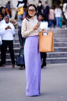 Yoyo Cao wears purple pants outside Elie Saab during Paris Fashion Week Womenswear Spring/Summer 2018 on September 30 2017 in Paris France